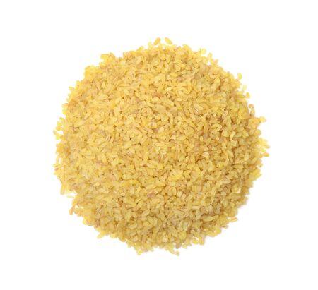 Heap of dry bulgur wheat isolated on white background. Top view. Zdjęcie Seryjne