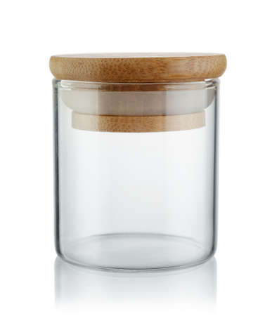Empty storage kitchen jar with wood lid isolated on white. 스톡 콘텐츠