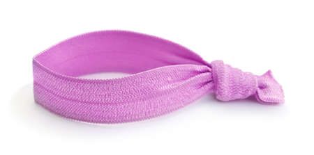 Pink textile hair tie isolated on white.