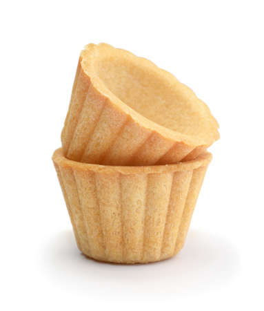 Two fresh empty tartlets isolated on white.