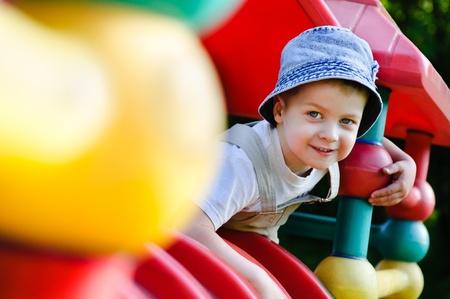 Little boy on playground photo