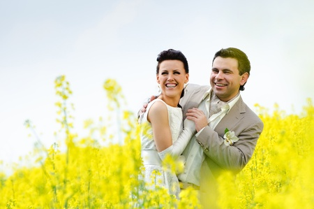 adult rape: newly-married couple in a rape field Stock Photo