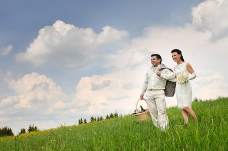 young attractive couple bride and groom in an open field