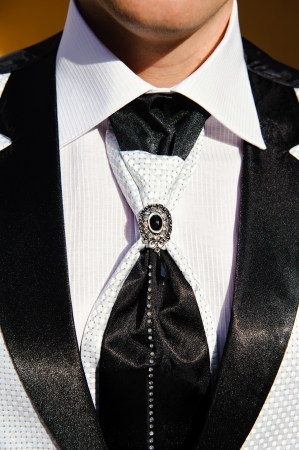Close up of groomsman wearing Tuxedo photo