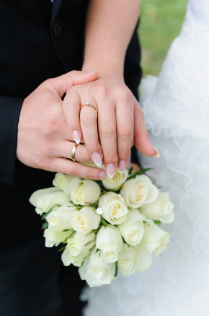 Wedding hands, Bouquet of roses photo