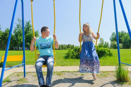 Couple having fun on the swing.