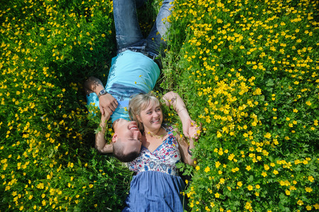 Young beautiful couple lying on the grass