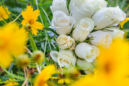 Wedding bouquet and rings in yellow flowers