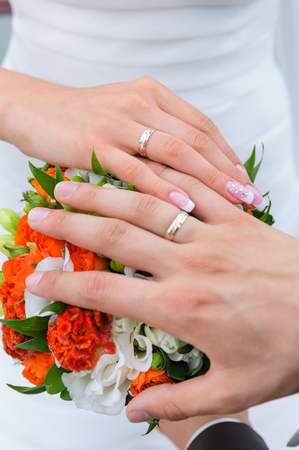 Couples hand with wedding rings