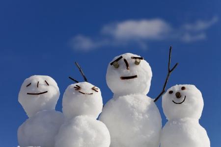 sunny cold days: Snowman family Stock Photo