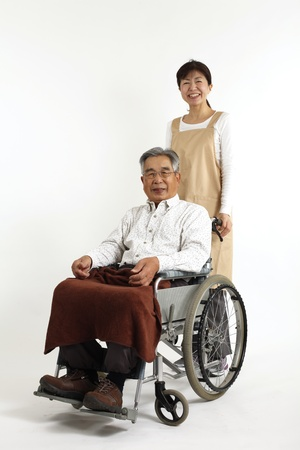 Old man who sat in a wheelchair with nurse care Stock Photo