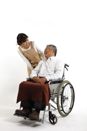 Old man who sat in a wheelchair with nurse care Imagens