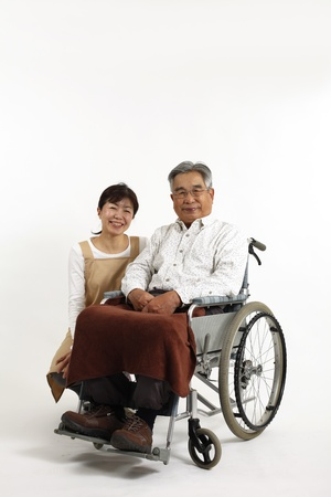 Old man who sat in a wheelchair with nurse care photo