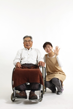senior carers: Old man who sat in a wheelchair with nurse care Stock Photo