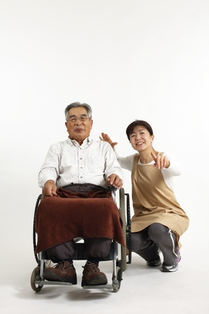 long term care services: Old man who sat in a wheelchair with nurse care Stock Photo
