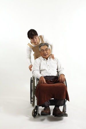 sat: Old man who sat in a wheelchair with nurse care Stock Photo