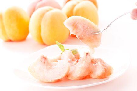 Japanese white peaches on white 写真素材