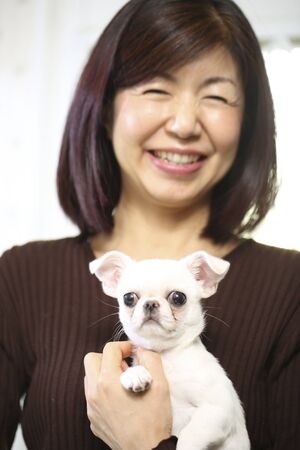 Japanese woman holding a pet dog