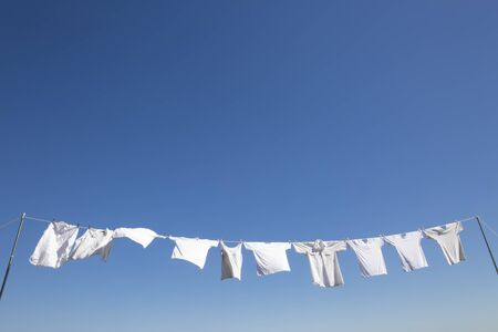 Laundry that flutters in the wind in the clear blue sky