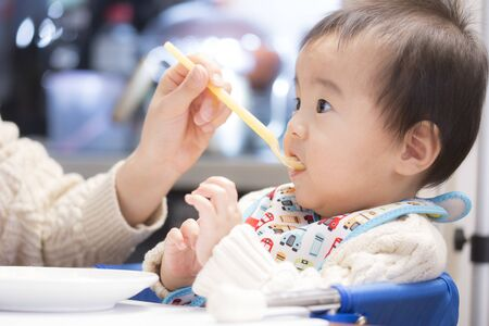 Baby field consecutive pictures that willingly eat baby food