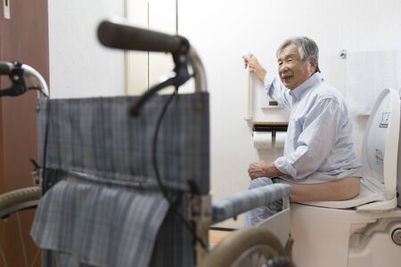 Japanese senior man defecate in a barrier-free toilet
