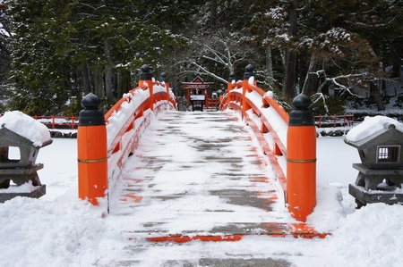 shrine: Bridge in japanese garden,Snow scene Stock Photo