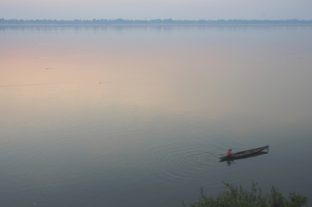 A boat crossing the Mekong River at sunset  Four thousand islands in Laos photo