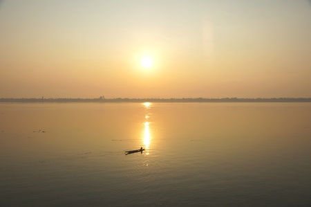 A boat crossing the Mekong River at sunset  Four thousand islands in Laos Stock Photo - 12965581