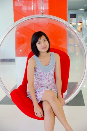 A pretty young woman sitting photo