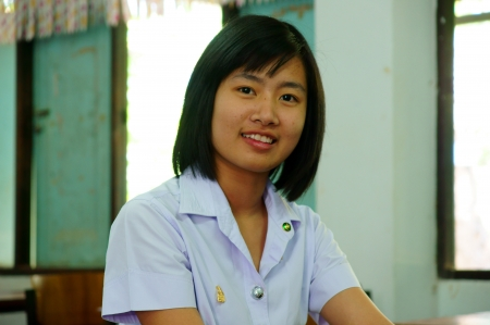 Young attractive female Asian student sitting photo