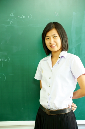 thai student: Young student woman near a school board Stock Photo