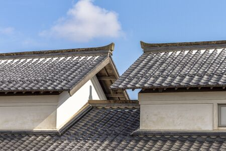 On a Sunny Day in February, Snow Still Remained on the Roof of a Japan House.