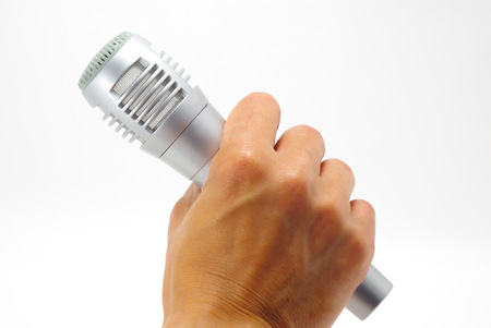 Hand having a microphone