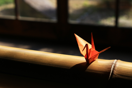 Origami crane which is placed on the window side of Japanese style houses Фото со стока