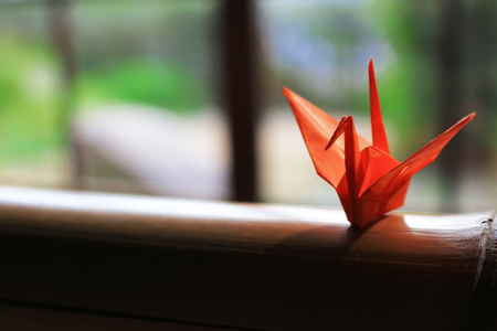 Origami crane which is placed on the window side of Japanese style houses Stock Photo