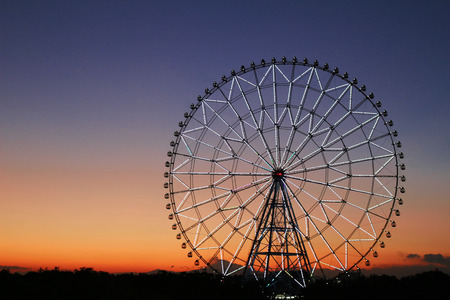 Ferris wheel in the sky of sunset