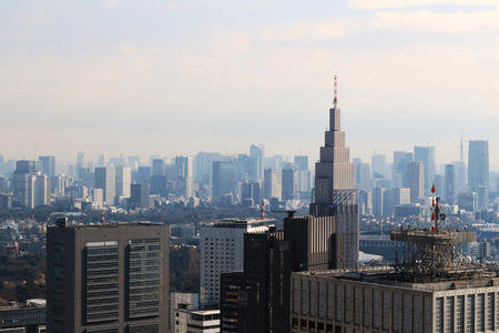 A view of Tokyo with a cell phone radio tower and various buildings