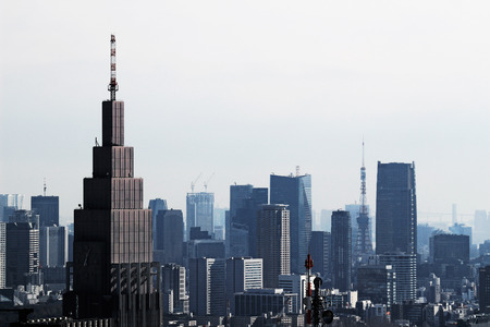 A view of Tokyo with a cell phone radio tower and various buildings 免版税图像