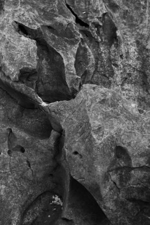 Black and white photo of a strangely shaped rock expression