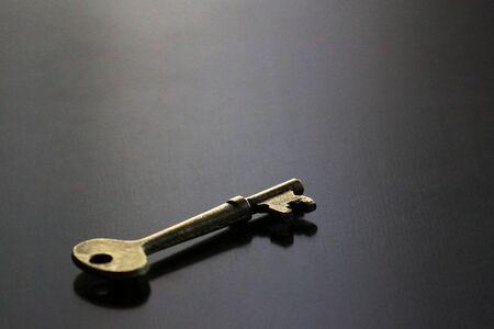 Still life of antique brass key