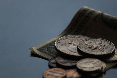 Shabby dollar bills and coins still life Stockfoto