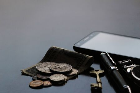 Still life of male cool belongings with dollar bills and coins Stockfoto
