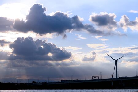 A wind power generator built in a dramatic sky