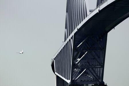 Tokyo Gate Bridge and jetliner