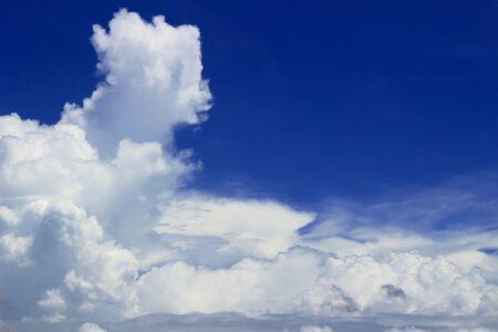 Landscape of cumulonimbus clouds floating in sunny summer sky Фото со стока
