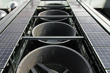 Outdoor equipment installed on the roof of a skyscraper with large exhaust vents, solarpays and live cameras Stock Photo