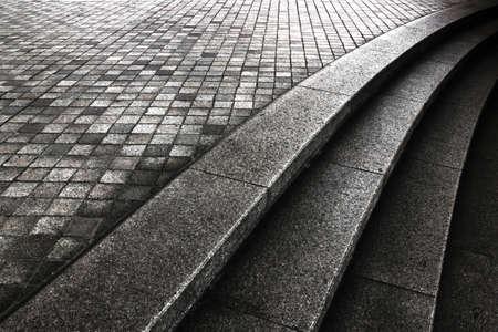 Monochrome photo of stone steps and stone pavements