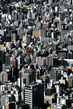 Cityscape of old town Tokyo where various large and small apartments are overcrowded