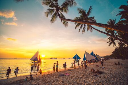 BORACAY, PHILIPPINES - 12 April 2019: People enjoying a spectacular sunset at Boracay island in Philippines.