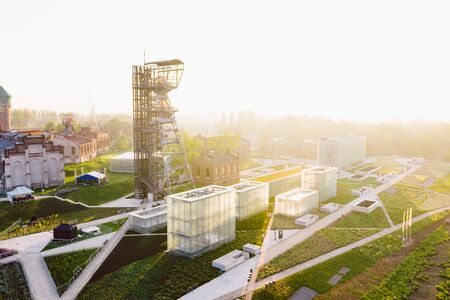 KATOWICE, POLAND - JUNE 08, 2019: The modern buildings of Silesian Museum accompanied by a shaft of the former coal mine